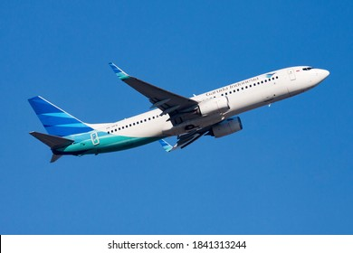 Hong Kong / China - December 1, 2013: Garuda Indonesia Boeing 737-800 PK-GFQ passenger plane departure and take off at Hong Kong Chek Lap Kok Airport