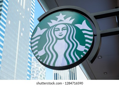 Hong Kong, China - December 18, 2018: Starbucks sign outside a coffee shop in Hong kong. Starbucks Corporation is an American coffee company and the largest coffeehouse company in the world.