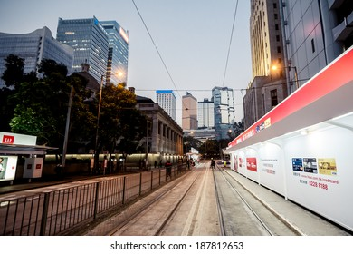 HONG KONG, CHINA - DECEMBER 21, 2013: City train rails and traffic on Hong Kong Island on December 21, 2013 in Hong Kong, China.