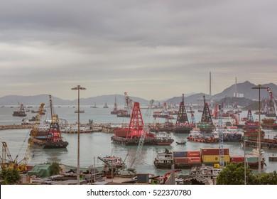 Hong Kong, China - December 21, 2015: Container ships at sea port Terminals in Hong Kong