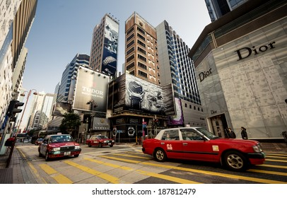 HONG KONG, CHINA - DECEMBER 22, 2013: Traffic with taxi cars in Kowloon District on December 22, 2013 in Hong Kong, China.