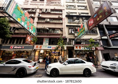 HONG KONG, CHINA - DECEMBER 22, 2013: Pedestrians and traffic in Kowloon District on December 22, 2013 in Hong Kong, China.