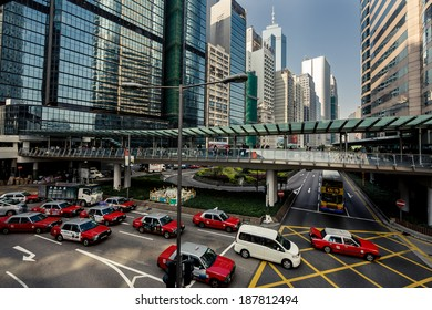 HONG KONG, CHINA - DECEMBER 23, 2013: City train rails and traffic on Hong Kong Island on December 23, 2013 in Hong Kong, China.