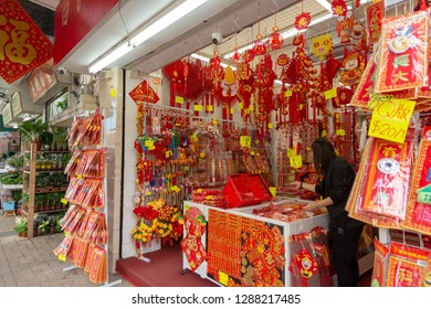 Hong Kong, China / December 29, 2018: Stall selling religious decoration to customers. Chinese Feng Shui Good luck charms. A good luck charm for every one and occasion.