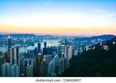 Hong Kong, China - December 30 2016 : Night scenery of Hong Kong viewed from top of Victoria Peak with city skyline of crowded skyscrapers by Victoria Harbour & Kowloon area across seaport