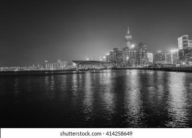 HONG KONG, CHINA - DECEMBER 30, 2013 - landscape of hong kong illuminated skyscrapers reflected in the Chinese sea at night