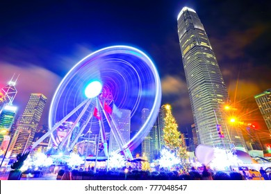 Hong Kong, China- December 31, 2016: View of the skyline with International Finance Centre and Observation Wheel in the financial district of Hong Kong at night on December 31, 2016.