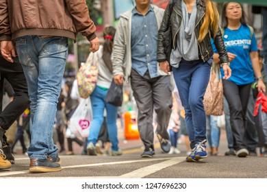Hong Kong, China - December 6, 2016: asian families and tourists walking through the crowded Causeway Bay shopping district, a popular roadside bazaar to shop.