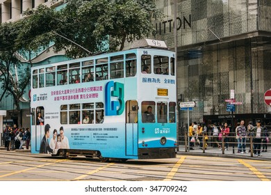 HONG KONG, CHINA - DECEMBER 6: famous double-deck tramcar running on the street of the downtown in Hong Kong, special administrative region of the People's Republic of China on December 6, 2015.
