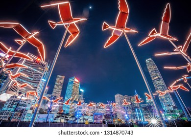 Hong Kong, China - Feb 12,2019 : Hong Kong Pulse Light Festival 2018 & International Light Art Display, People taking photos and enjoy the show.