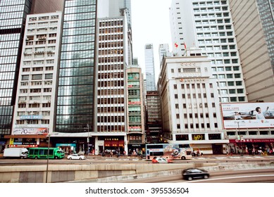 HONG KONG, CHINA - FEB 13: Levels of traffic on streets with skyscrapers and fast driving taxi cars on February 13, 2016. Hong Kong dollar is the eighth most traded currency in the world.