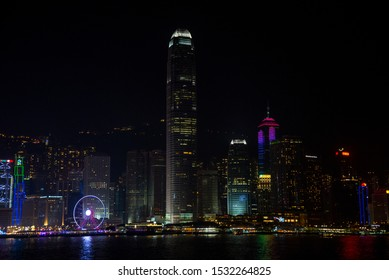 Hong Kong / China - Feb 2017: Aerial skyline cityscape of Victoria Bay with a few different skyscrapers. Night colorful view of Never Sleep City Hong Kong.