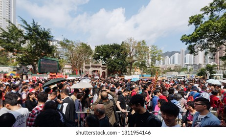 Hong Kong, China - Feb. 7, 2019: Crowded day at Sik Sik Yuen Wong Tai Sin Temple in Hong Kong during spring festival. Wong Tai Sin is a Chinese deity popular with the power of healing.