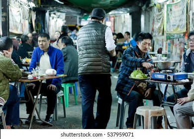 HONG KONG, CHINA - FEB 8: People tasting food at a outdoor Chinese restaurant in the late evening on February 8, 2016. More than 47 million tourists visit Hong Kong annually
