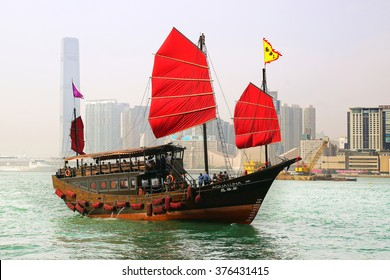 HONG KONG, CHINA - FEBRUARY  15, 2013: Hong Kongâ??s iconic traditional red-sailed Chinese Junk Aqua Luna. The junk boat is the logo of the Hong Kong Tourism Board.