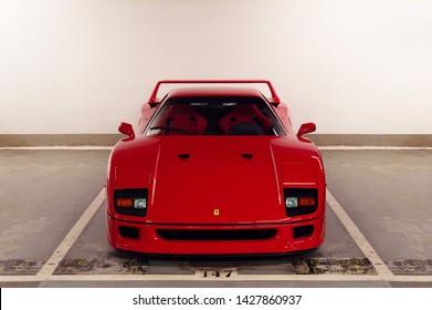 Hong Kong, China - February 2019: A bright red Ferrari F40 supercar in an underground garage. This rare, classic Ferrari is worth more than a million US dollars.
