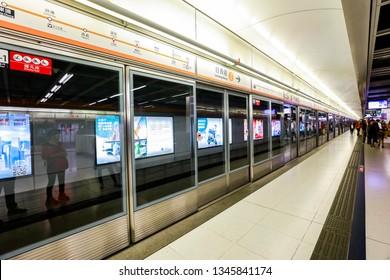 Hong Kong, China - February 6, 2019:Passengers take the subway to Hong Kong Island at the subway station. Mass Transit Railway is a member of the International Metro Federation (CoMET).