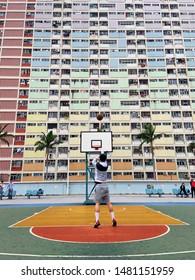 Hong Kong, China / China / February 8, 2019: Playing basketball at Choi Hung Estate