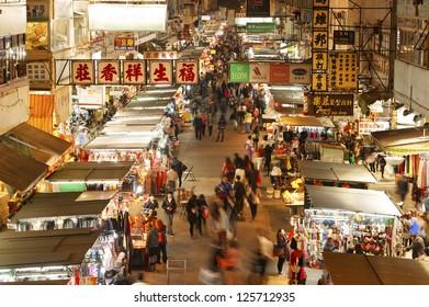 HONG KONG , CHINA - JAN. 16 : Flea market on Jan 16, 2013 in Hong kong. The flea market in Mongkok District is the most famous flea market in Hong Kong and attract many tourists.