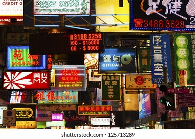 HONG KONG , CHINA - JAN. 16 : Mongkok at night on Jan 16, 2013 in Hong Kong, China. Mongkok in Kowloon is one of the most neon-lighted place in the world and is full of ads of different companies.