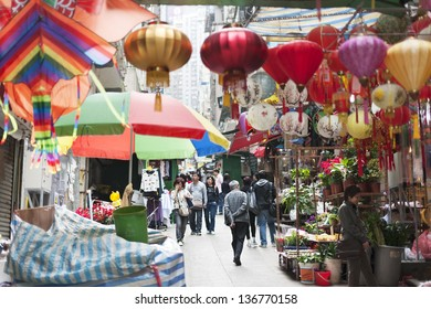 HONG KONG , CHINA - JAN. 16 : People walking in bazaar to shop Chinese Lantern and decoration stuffs for Chinese New Year on Jan 16, 2013 in Hong kong.