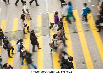 HONG KONG, CHINA - JAN 7, 2010: aerial view of people crossing a street at a pedestrian crossing.
