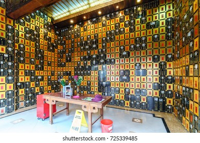 Hong Kong, China - January 14, 2016: Po Fook Memorial Hall (columbarium) is burial ground in Shatin for human ashes after cremation providing about 100000 niches. Ancestral niche interior view