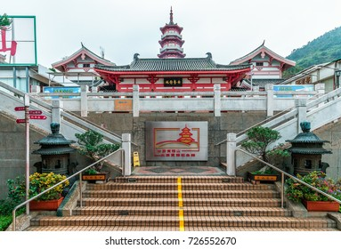 Hong Kong, China - January 14, 2016: Po Fook Memorial Hall (columbarium) is burial ground in Shatin with big jumble of traditional style buildings piled up around big pagoda in middle. Entrance view