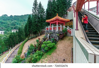 Hong Kong, China - January 14, 2016: Po Fook Memorial Hall (columbarium) is burial ground in Shatin. Elevator lifts people to the top of the complex