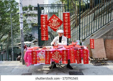 Hong Kong, China - January 18, 2014 : Writing Chinese New Year antithetical couplets, they can better be described as a written form of counterpoint.