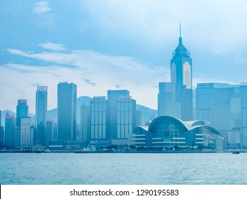 HONG KONG, CHINA - JANUARY 20 : Landmark skyscraper buildings at Victoria harbor with daylight mist, Hong Kong, China, on January 20, 2018.