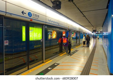 HONG KONG, CHINA - JANUARY 26, 2017: Unidentified people in the subway train station in Hong Kong. MTR is the most popular transport in Hong Kong