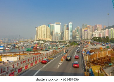 HONG KONG, CHINA - JANUARY 26, 2017: Construction site of pier, witrh some cars in a road with a city in the horizont in Hong Kong, China.