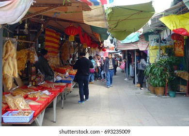 HONG KONG, CHINA - JANUARY 26, 2017: Unidentified people buying resh seafood in a market, inside of a red baskets, in fishermen town in lantau, Hong Kong, China