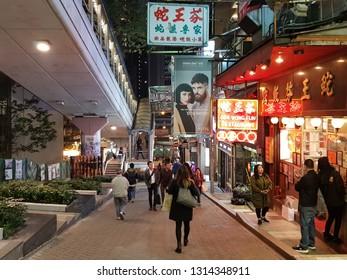 Hong Kong, China - January 29 2019: City life by the mid levels escalator in Hong Kong island at night.