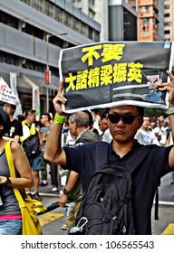 "HONG KONG, CHINA - JULY 1: Unidentified Hong Kong citizens participate in the annual July 1 march shouting ""No Liar! Leung Chun-ying"" (the new Chief Executive) on July 1, 2012 in Hong Kong, China."
