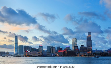 Hong Kong, China - July 1, 2019: The overview of Hong Kong Kowloon business district Skyline at sunset. Hong Kong is an autonomous territory, and former British colony, in southeastern China.