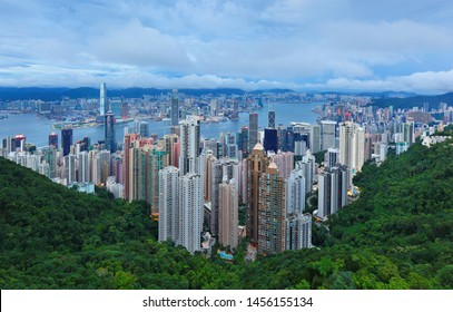 Hong Kong China - July 2, 2019: Overview of  Hong Kong Skyscraper and Victoia Harbor after sunset from Peak Tower near the summit of Victoria Peak, Hong Kong China.