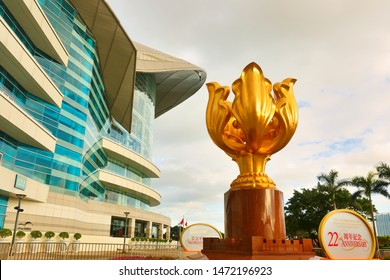 Hong Kong China - July 2, 2019: The giant statue of a golden Bauhinia blakeana at the Golden Bauhinia Square ona cloud day.