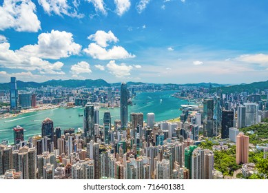 HONG KONG, CHINA - July, 2017 : Hong Kong cityscape from the Victoria Peak on a sunny day. Hong Kong is an autonomous territory on the Pearl River Delta of China.