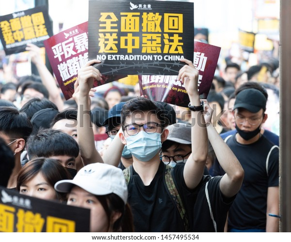Hong Kong, China - JULY 22, 2019: People protest on the street in hong kong. More than 100,000 protesters took to the streets of Hong Kong on Sunday to oppose a controversial extradition bill.