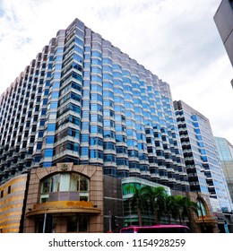 HONG KONG, CHINA - JULY 23, 2018: Famous hotel building with post modern design and dark glass windows isolated