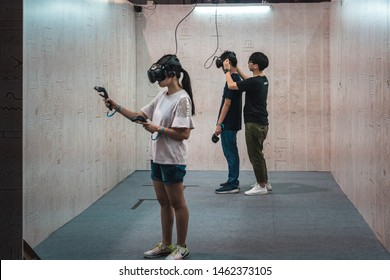 Hong Kong, China: July 26, 2019: Gaming fans attend the E-Sports & Music Festival; Gaming fans try the VR game at the exhibitor booths.