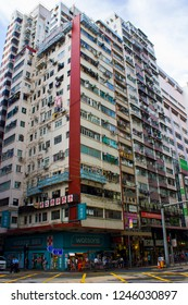 Hong Kong, China - July 27 2018: Picturesque high-rise residential buildings on Hennessy Road, Wan Chai district. Wan Chai is a metropolitan area situated on the northern shore of Hong Kong Island.