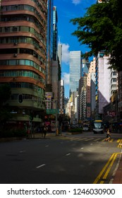 Hong Kong, China - July 27 2018: Old high-rise residential buildings alongside with modern skyscrapers at Hennessy Road, Wan Chai, with bright blue sky on the background. Busy streets of Wan Chai.