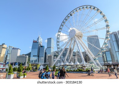 Hong Kong, China - July 29, 2015: Skyscrapers and Hong Kong Observation Wheel, which is the latest tourist attraction in the city.