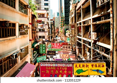 HONG KONG, CHINA - JULY 30, 2012: Street view with signs and buildings on July 30, 2012 in Hong Kong, China. With 7M population it is one of the most dense areas in the world