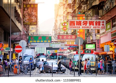 HONG KONG , CHINA - JULY 9, 2014 : Mongkok street, Unidentified tourists and workers are usually on foot to shop and have lunch. This market has many products and delicious restaurants.