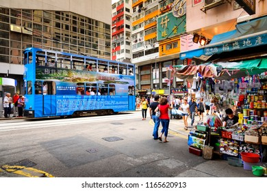 HONG KONG , CHINA - JULY 9, 2014 : Mongkok street, Transportation system of Hong Kong with the electric tram and private car and bus are very popular choice in the city.