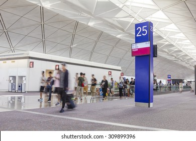 Hong Kong, China - June 26, 2015: Passengers with luggage in departure gate in the Hong Kong International Airport. The airport is one of the world's busiest passenger airports.